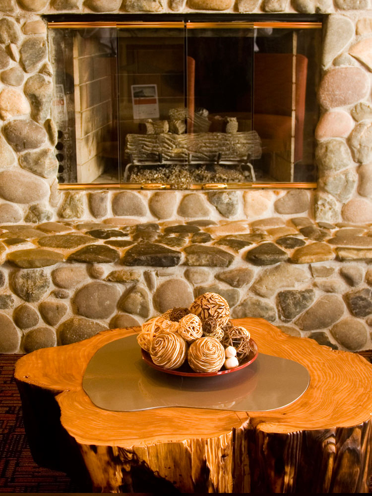 fire place and tree trunk table