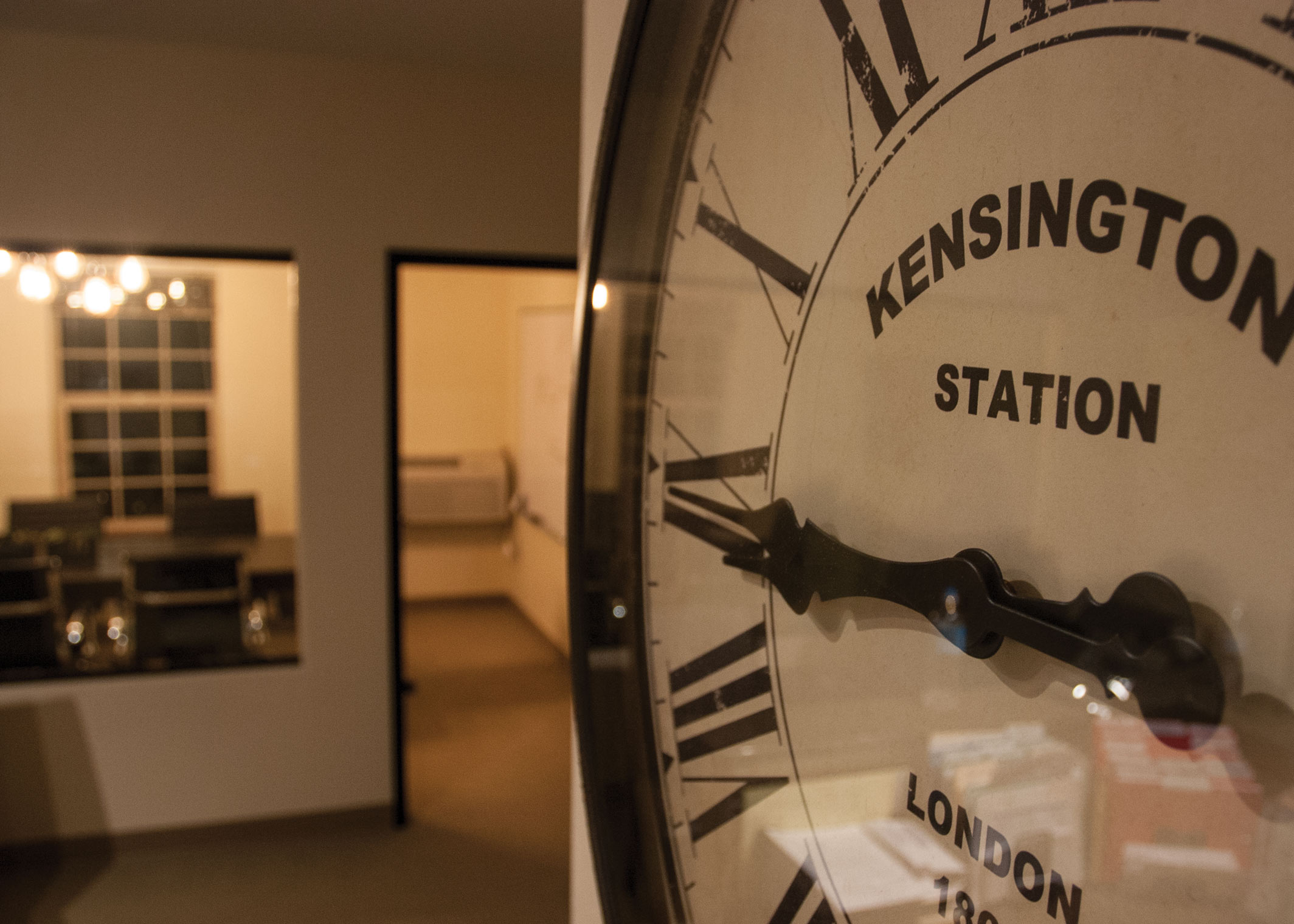 conference room in background, Kensington clock on the wall