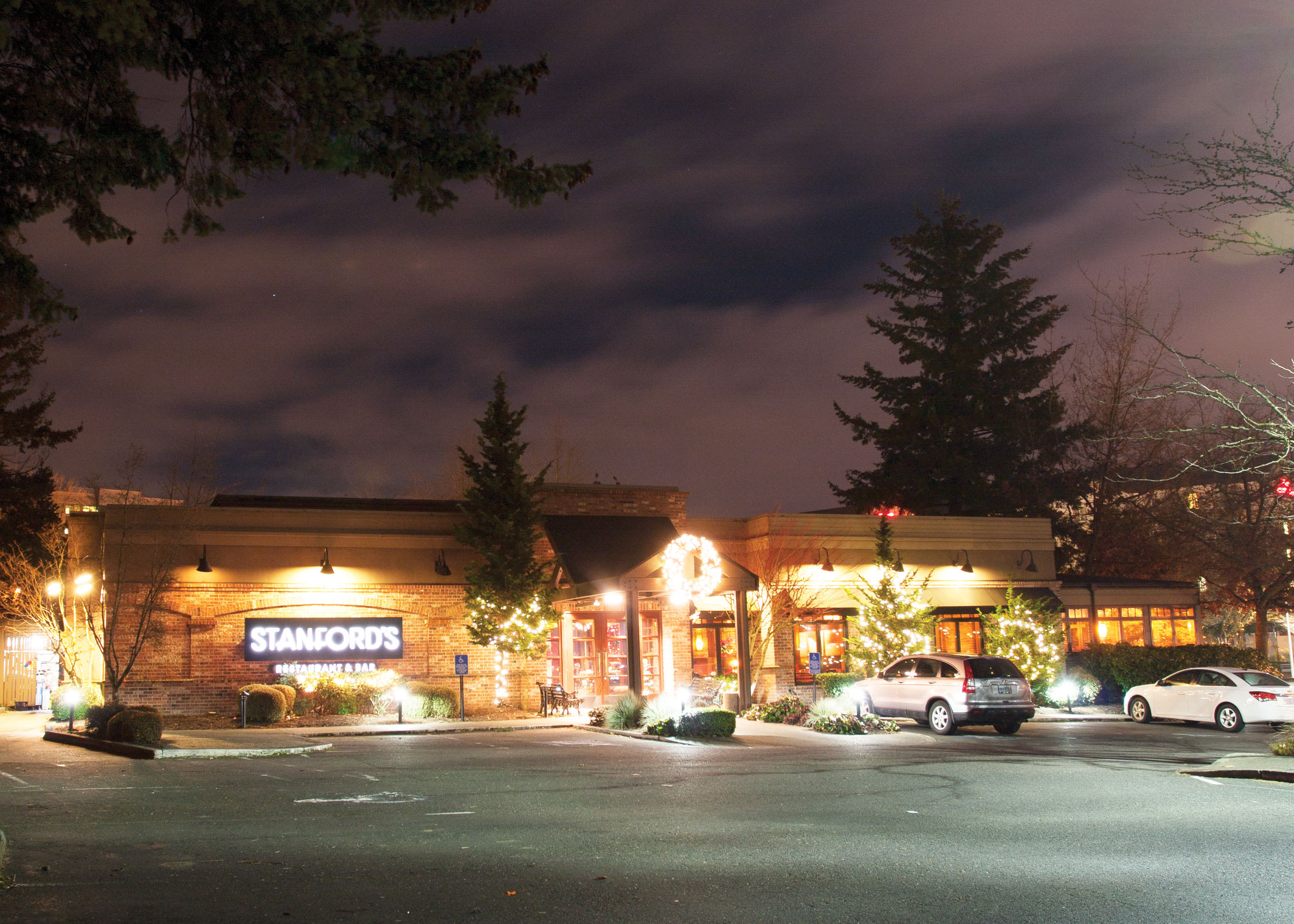 Stanford's restaurant store front at night