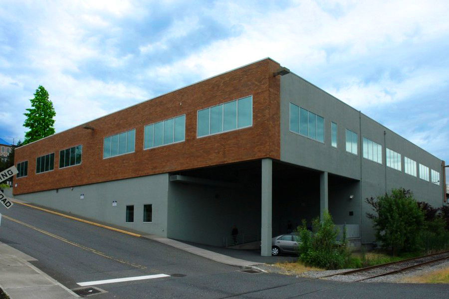 two story brick office building with carport