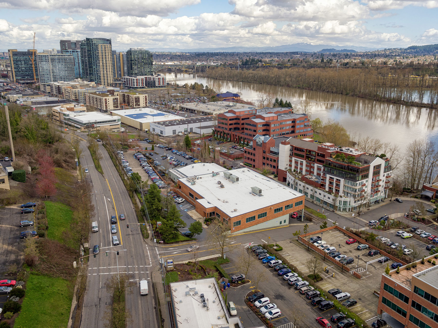 aerial view of office building with a lot of parking near river in Portland, Oreagon