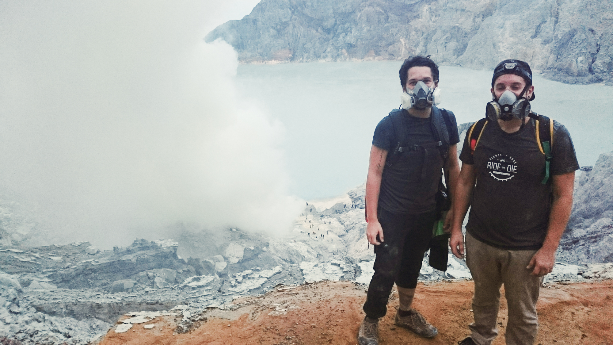 Mike & I inside a volcano's sulfer mine, in Indonesia on Christmas morning.