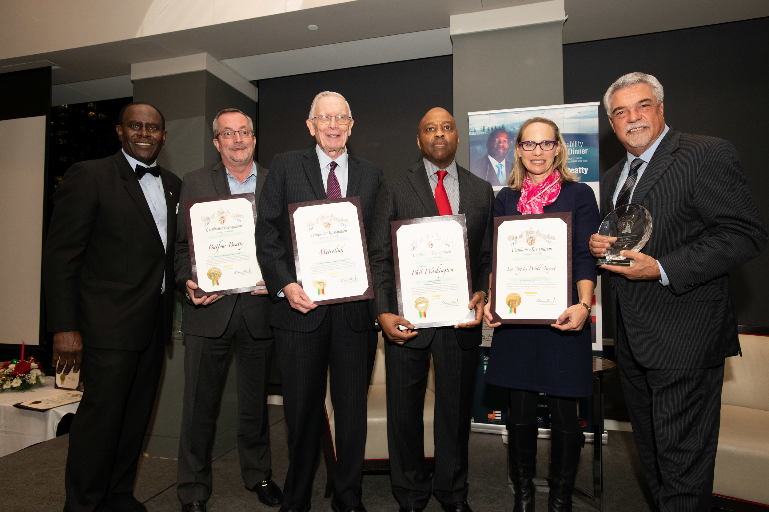 L-R Dr. Sherman Gay (LASC), Joe Reed (Vice President, Balfour Beatty, 2018 Construction Company of the Year Award), Larry McCallon (Mayor of Highland, 2018 Metro Outstanding Sustainability Program Award), Phil Washington (Metro Chief Executive Officer, 2018 Sustainability Leadership Award (Man of the Night)), Tamara McCrossen-Orr (Chief Planning Officer LA World Airports, 2018 Sustainability Public Agency of the Year Award), Albert Lord (Deputy, Los Angeles Council President Herb Wesson Jr. 2018 Los Angeles City Outstanding Sustainability Program Award)