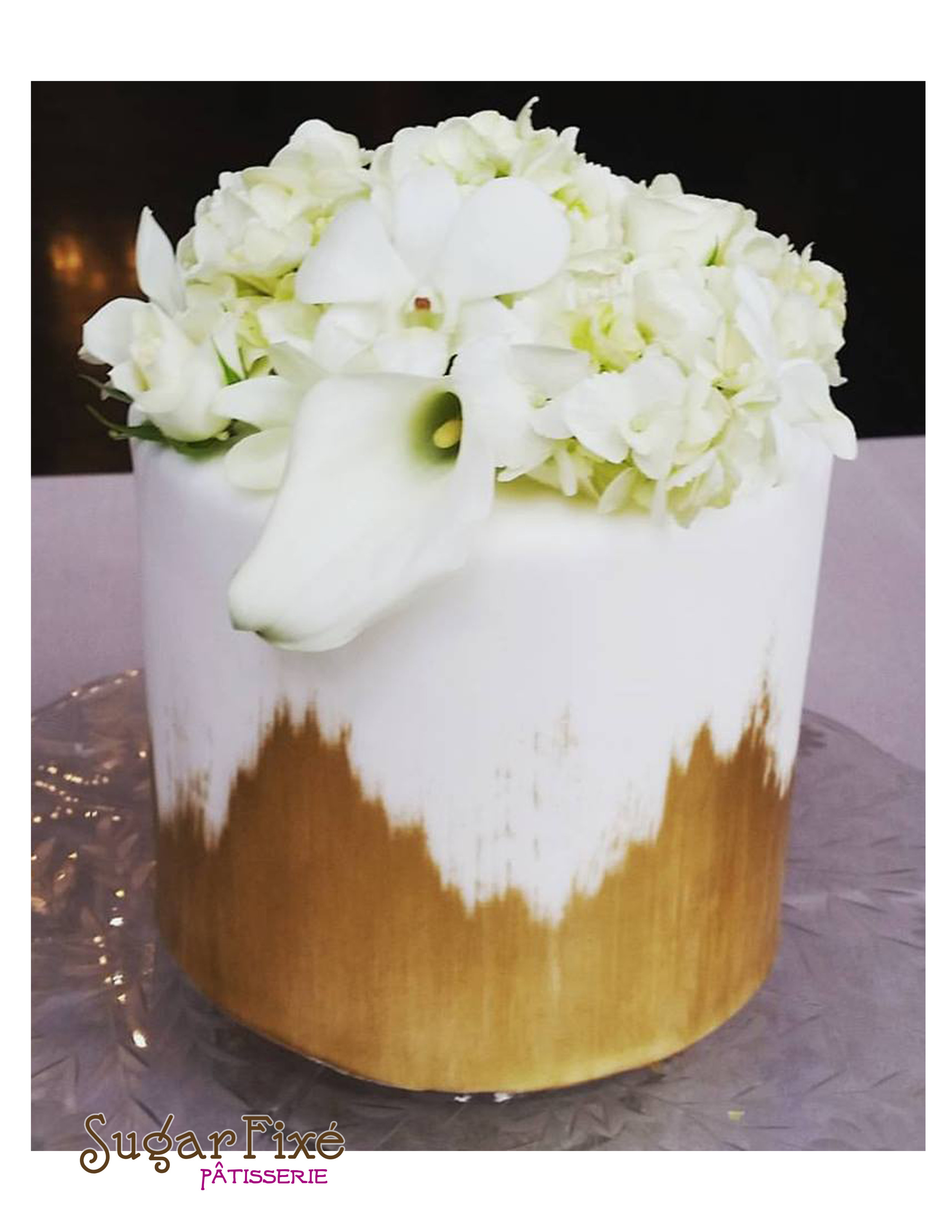 single tier gold brush fresh floral cake.jpg