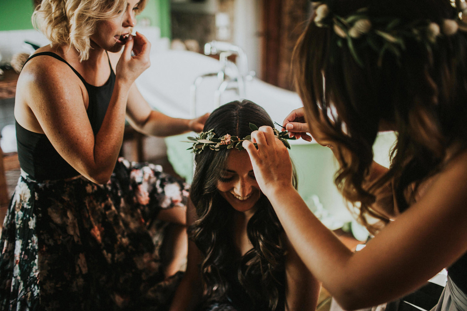 bridesmaids creating floral crowns in olivella