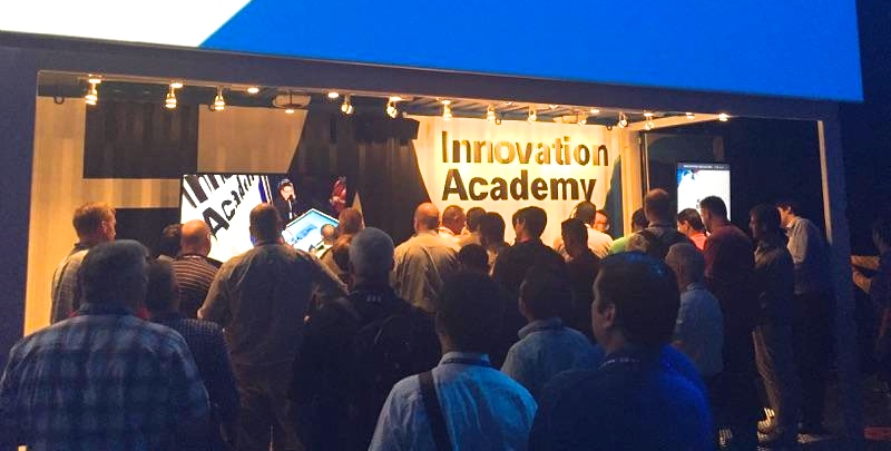 One of many presentations throughout the three days. There are so many people surrounding my booth that you can barely see my face, although you can see me in the video being watched by some of the attendees.