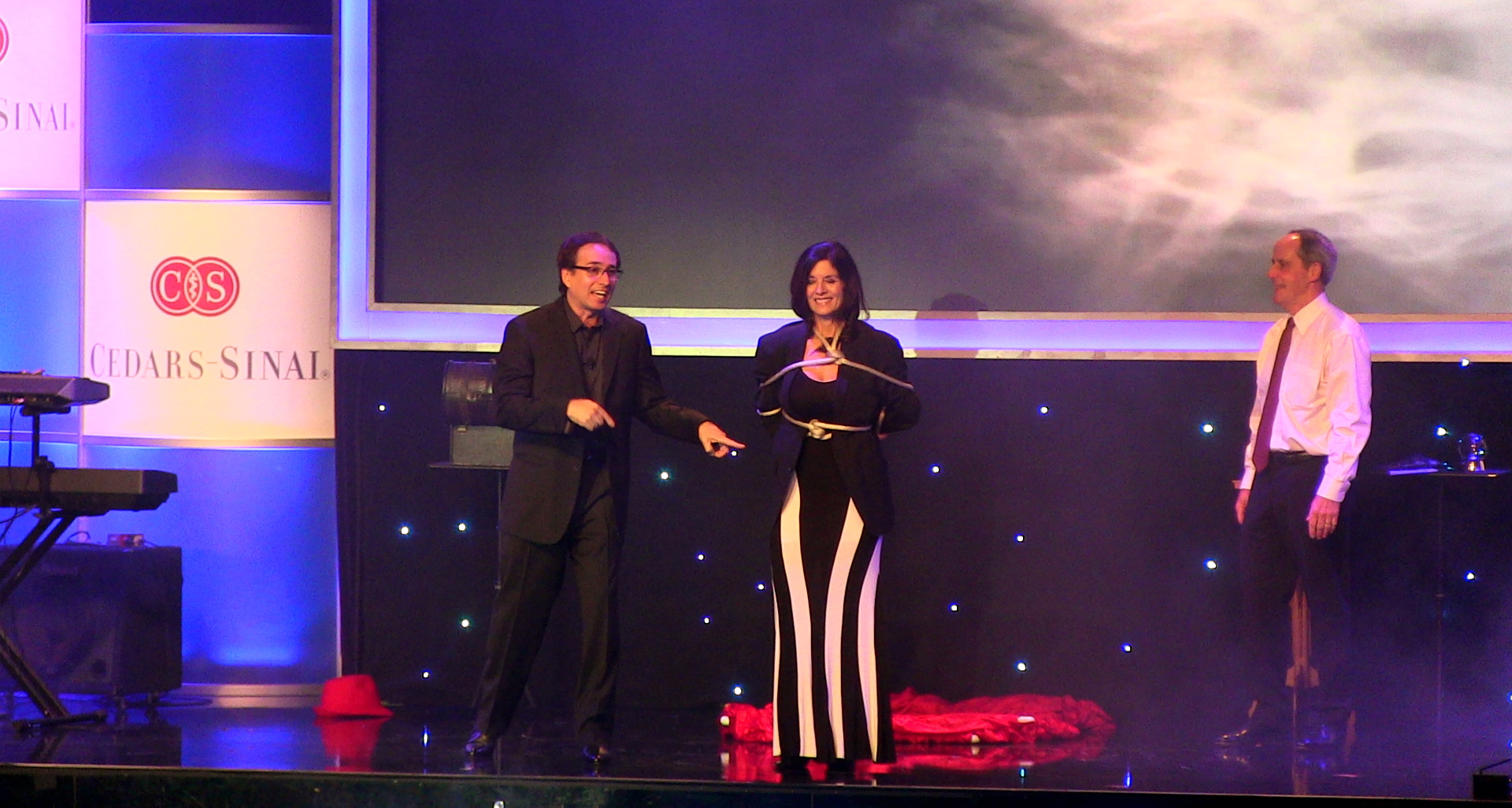 Corporate magicians, Lou Serrano and Dee Dee, performing in front of 500 people at a Corporate event  N BEVERLY HILLS, CA for Cedars-sinai Medical Center.