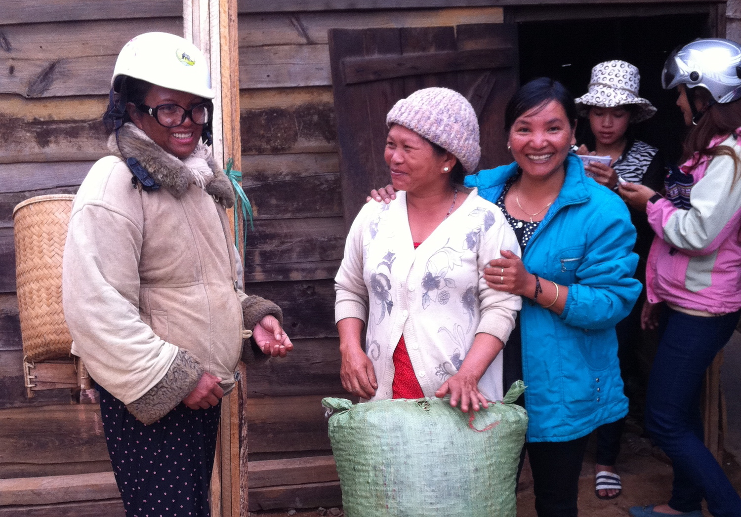 Receiving the coffee from farmers after a day harvesting.