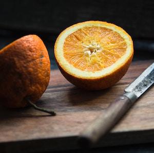 orange-in-half-with-knife-jonathan-pielmayer-unsplash.jpg