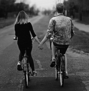 couple-riding-bicycles-sabina-ciesielska-unsplash.jpg