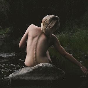 curved-back-young-woman-casper-nicholls-unsplash.jpg