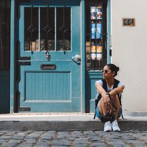 woman-outside-doorway-patrick-pierre-unsplash.jpg