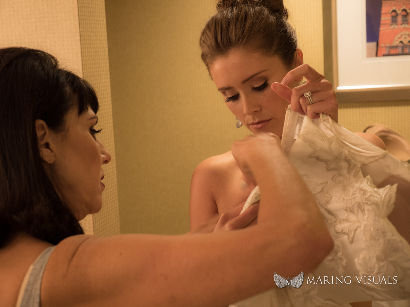 Slipping on the Wedding Gown