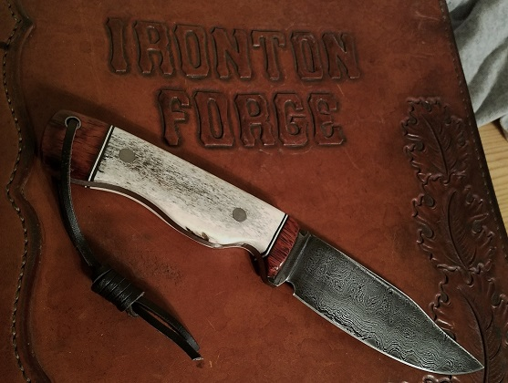- Hand forged damascus knife, elk antler and cherry handle, 9