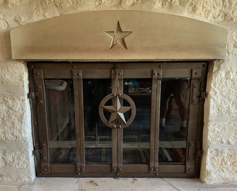 Lone Star bi fold fireplace doors in Bertram, Texas.