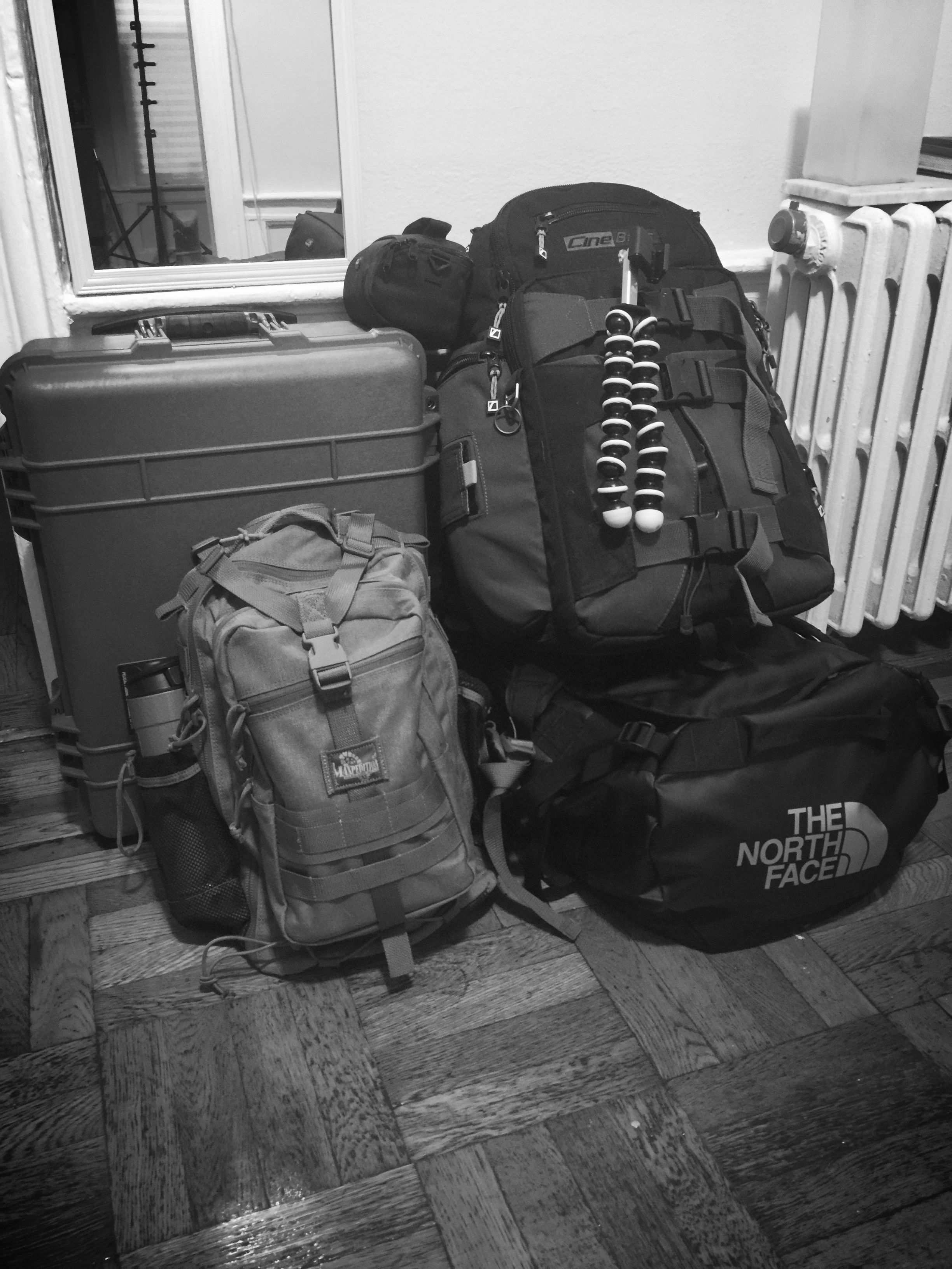 FOOD FOR THOUGHT: This is what overpacking looks like. On my last trip, 75% of this gear didn't get used. Everything that did fit into the bag on the bottom left.