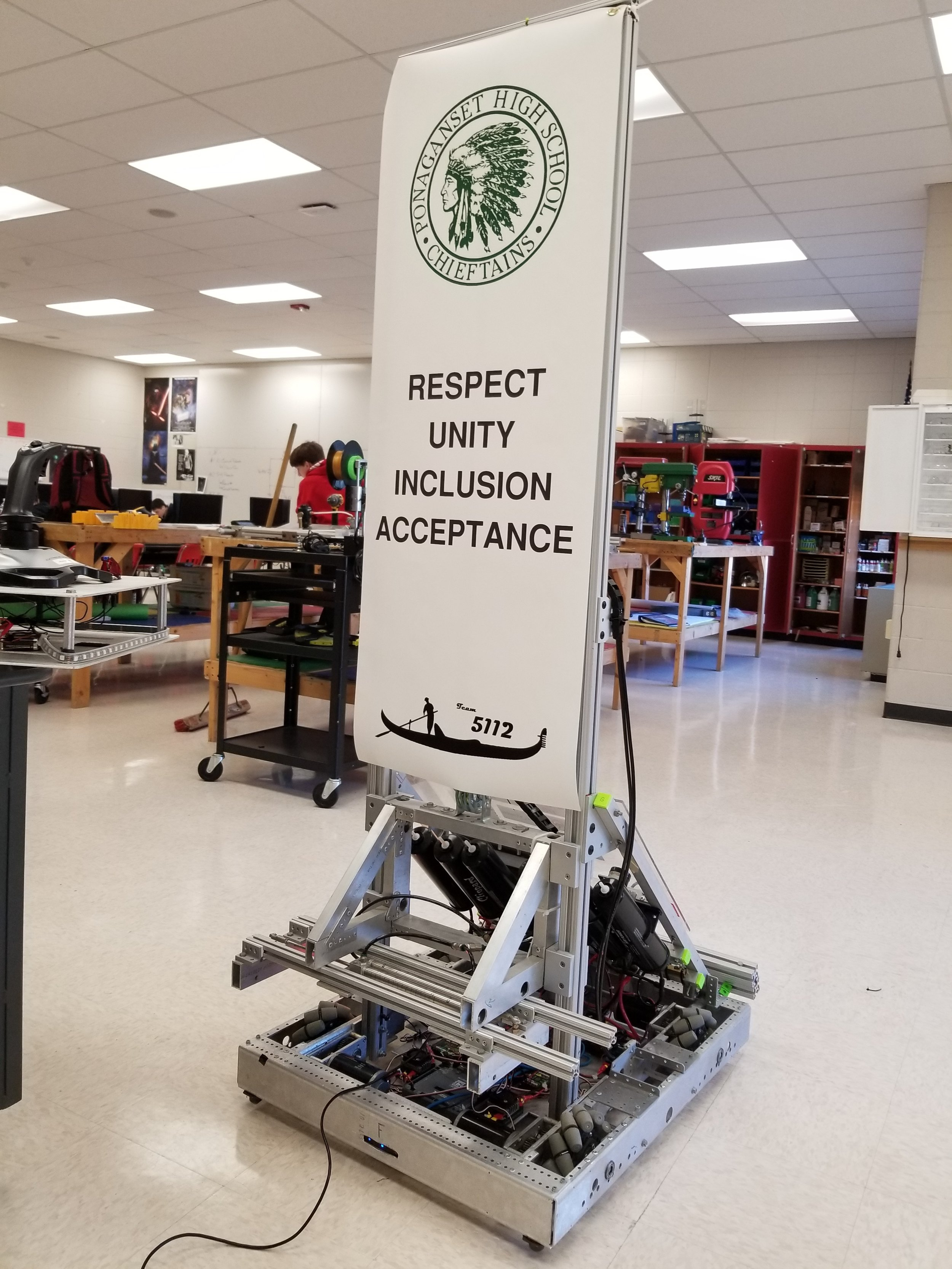 Ponaganset High School received the Special Olympics National Unified Champion School banner and we decorate our robots for the ceremony!