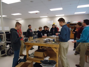 Discussing the robot chassis at an after school meeting