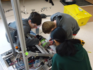 Emillie and Zach (our Director of Design), our two pneumatic geniuses, working with a freshman on our team.