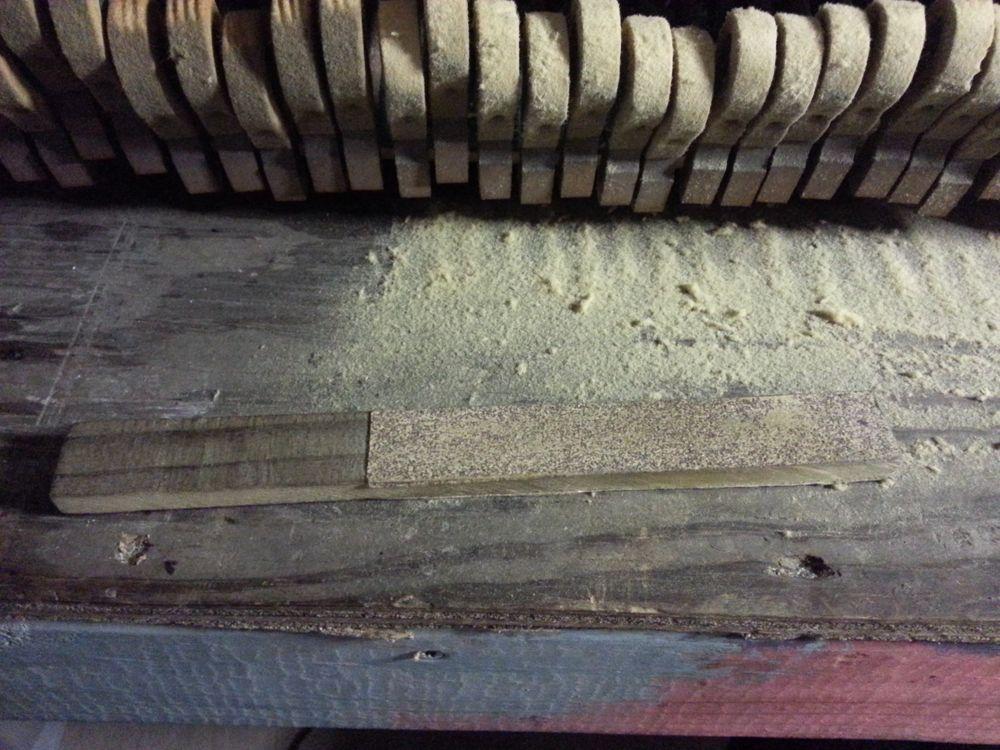 A hammer sanding block.