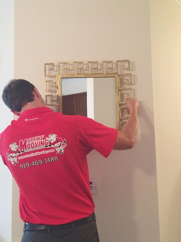 Marrin's Moving installing our beautiful Greek key mirrors