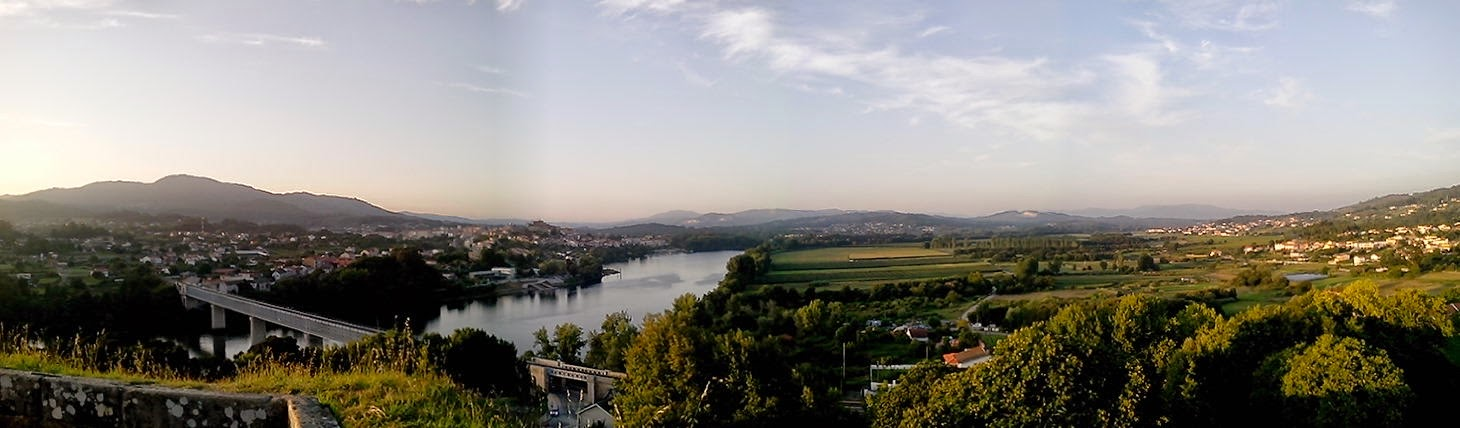 LeftL Tui, Spain. Right: Valença,Portugal. The Minho river is the naturalborder between the countries