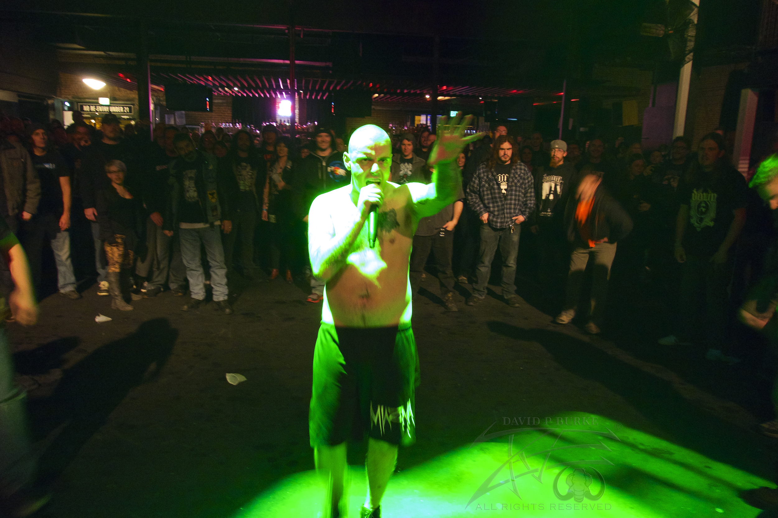 "King Parrot's ""Youngy"" getting the crowd ready to thrash him in the pit.    photo: David Burke"