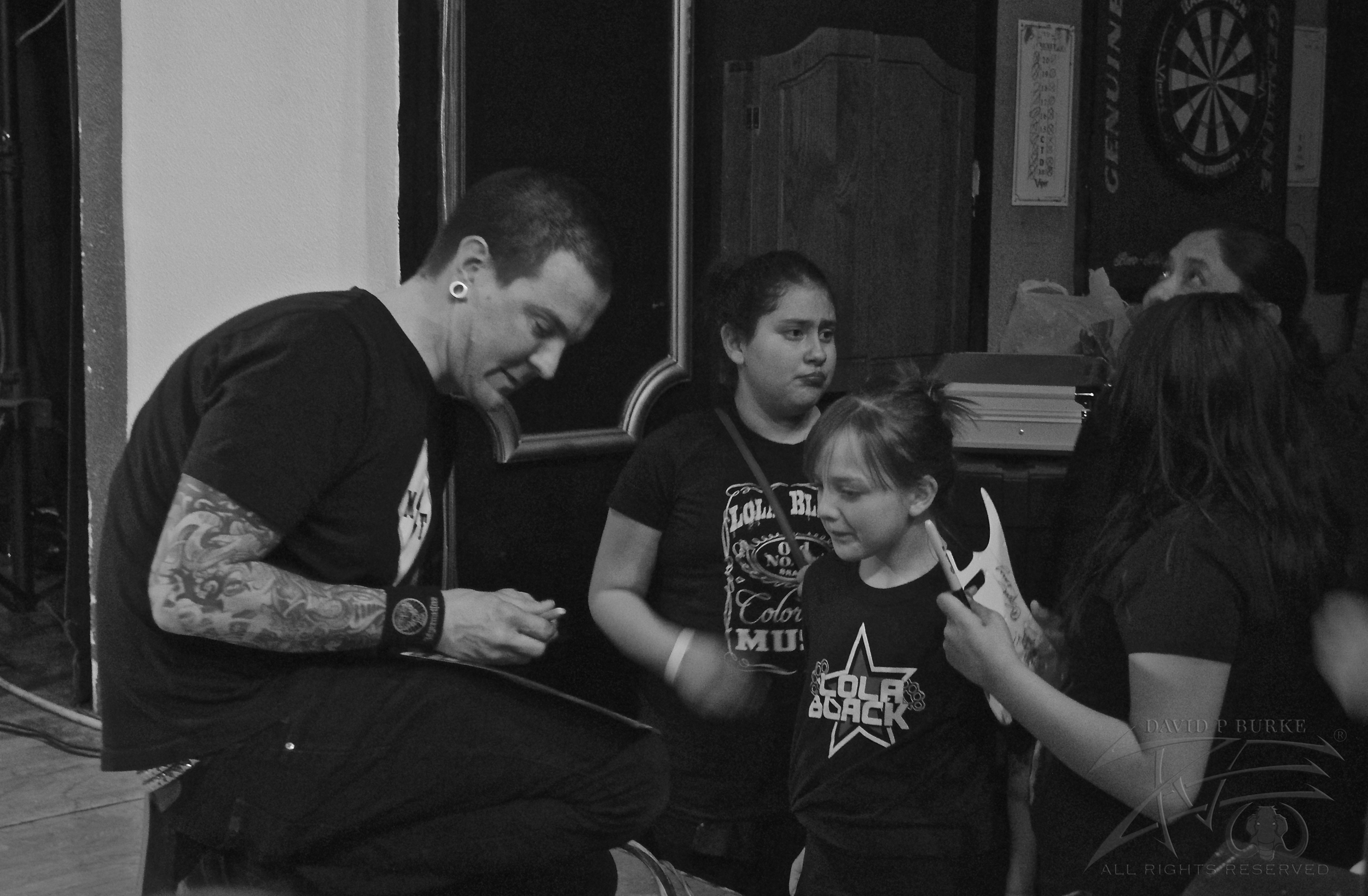 Lola Black guitarist Chris Dellinger gives his young fans the utmost respect before the show   photo: David Burke