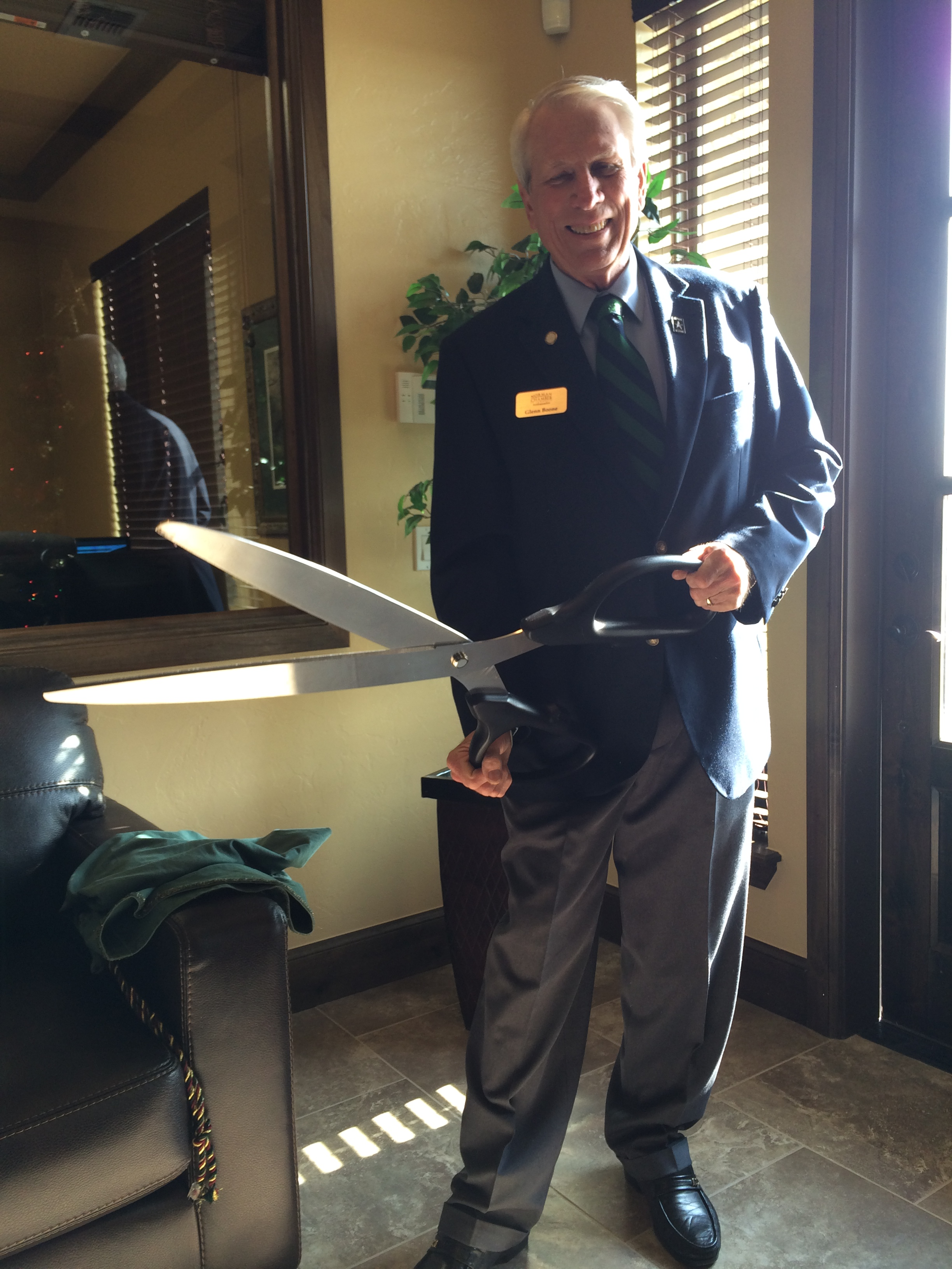 Who doesn't love giant scissors?     Careful they are sharp!    Pictured above, Glenn Boone, Chamber Ambassadors Committee and keeper of the scissors.