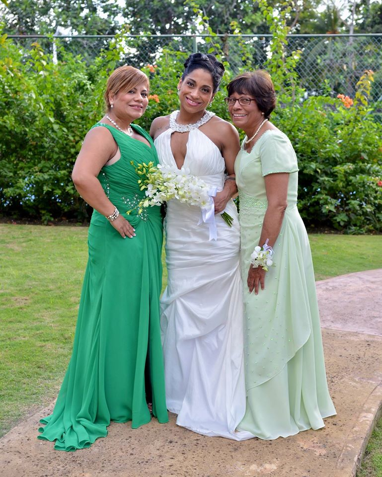 The beautiful bride, mother of the bride and Maid of Honor all wearing their custom tailored gowns done by Rosi's Bridal Studio