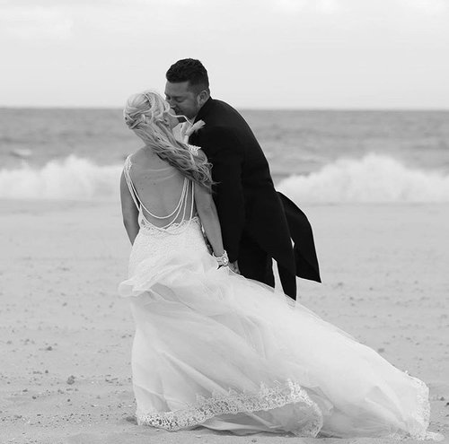 """- """"My Wedding dress was beautiful and I have gotten some many compliments! Still waiting on the pictures from photographer to share. Aida did a fantastic job customizing the dress to fit me and my expectations. The studio is lovely and clean. My mother and I drove from PA 2 1/2 hours to Nj each way and didn't mind it a bit. Aida even suggested a nice Greek restaurant that we would go to every visit. Our communication was thur email/fb and 3 visits. One to take measurements/final dress details , second to try on and make sure everything was fitting properly and lastly for final fitting. You may look at pictures and want the exact look of a dress or dresses put together but in the end you will have a whole new look all your own with all the fabric choices. Thanks again Aida, you were wonderful to work with and I would recommend brides your way any day! """"  - Deanndra"""