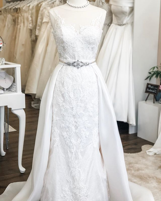 This beautiful dress is part of our very own private collection.  We coupled it with a custom #mikado skirt which was made in-house.  The look was beautifully finished with a @blossomveils crystal sash... experience a fully customized look, here at Rosi's! #mondaymood