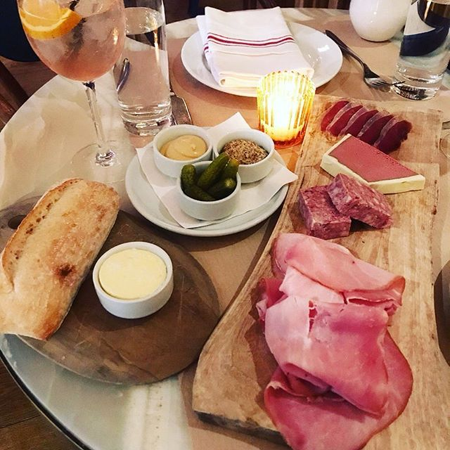 Charcuterie and a crusty baguette - a classic French pairing. Merci @eatprayloveny for the 📸