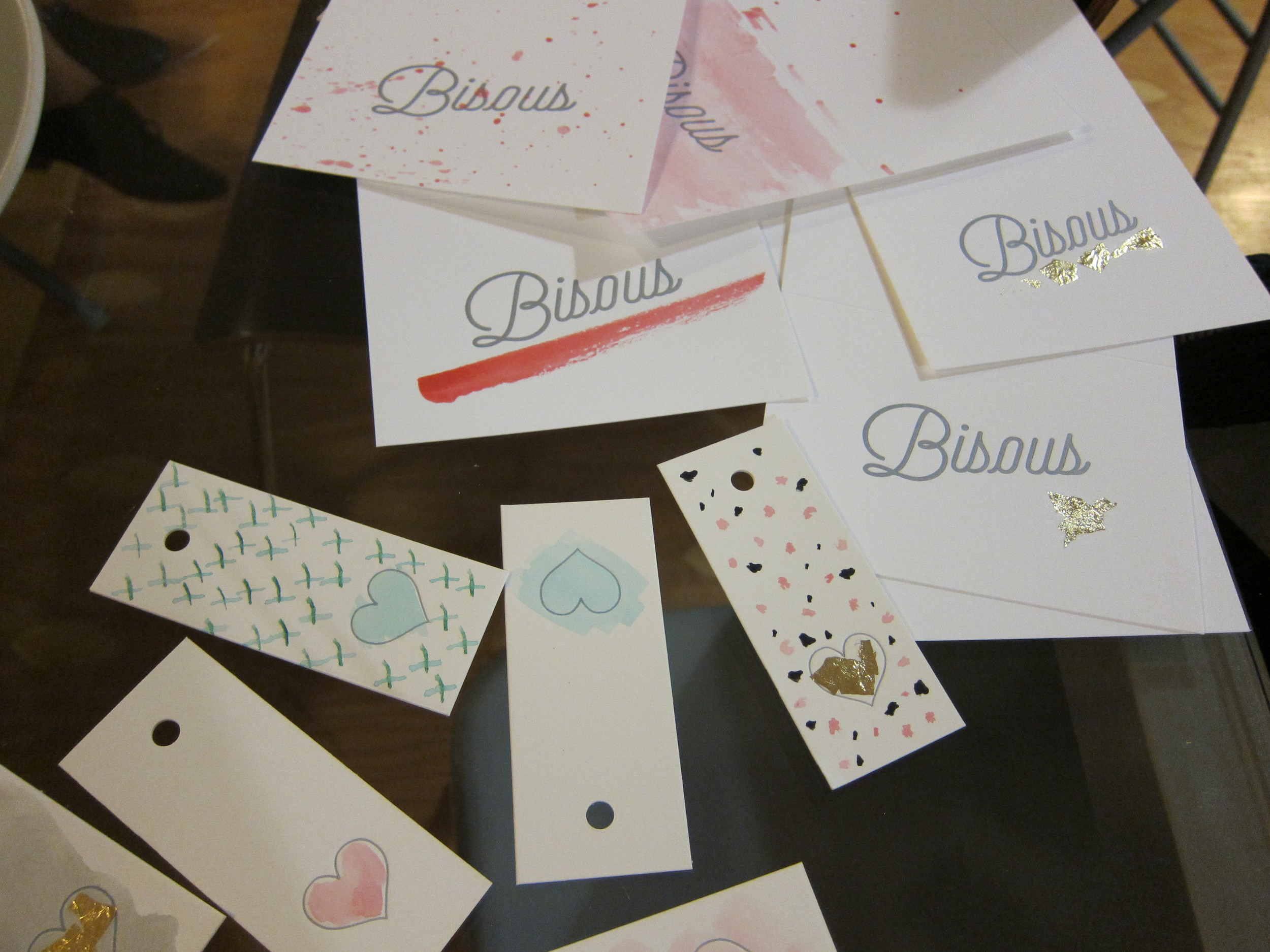A few of our finished cards, embellished with watercolor paint and gold foil.