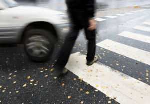 pedestrian-walking-crosswalk-300x207.png