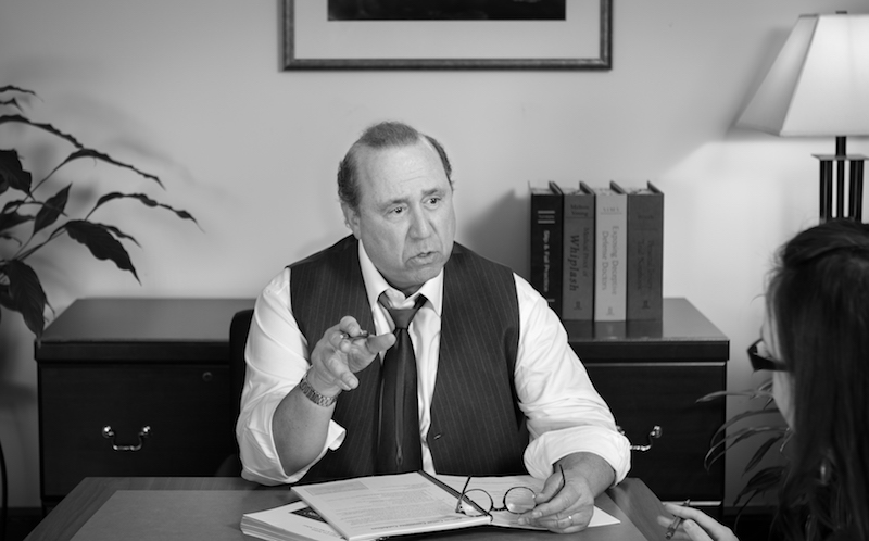 adam in a meeting, straight shot, black and white.jpg