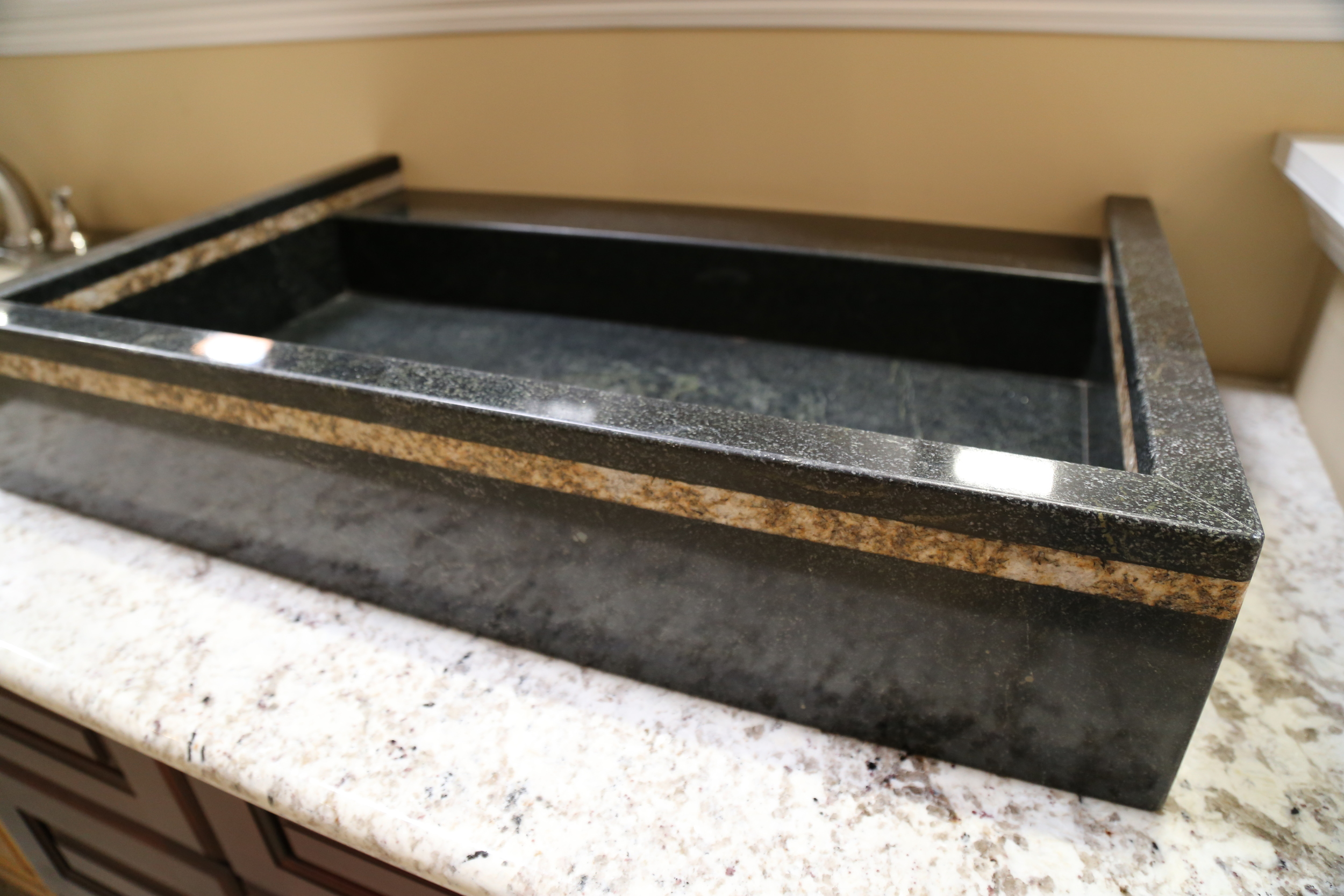 Custom stone sinks are also available.