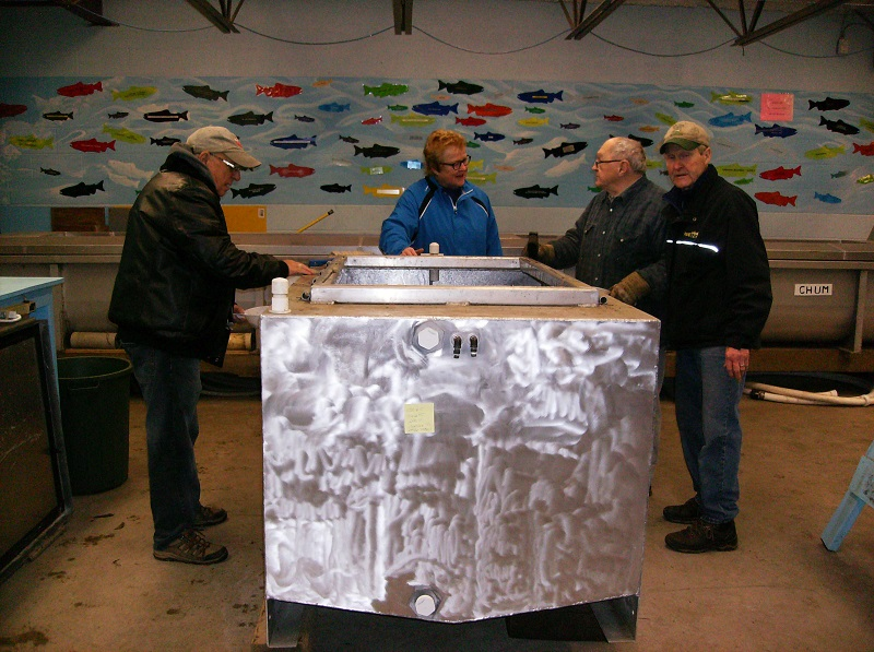 Tank Work - December 16, 2017Big tank you to Gert who cleaned off the older decals and polished up the fish transport tank. Inspectors, Larry, Helen & Shane assisting Gert.