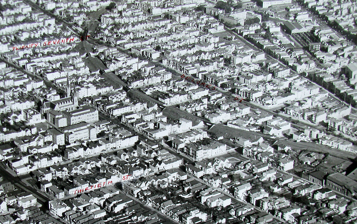 1940's aerial clearly showing the train route cutting through the gird        image: foundsf.org