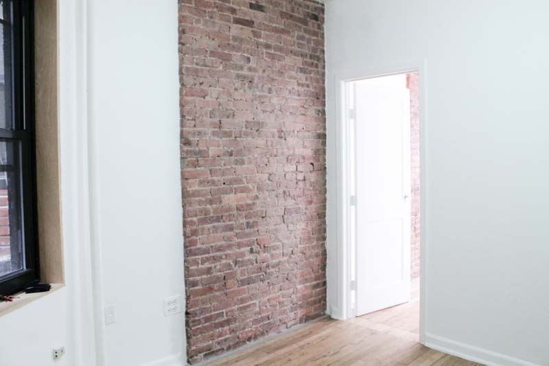 Our living room has exposed brick and while it doesn't get a ton of natural light, it is a really cozy space.