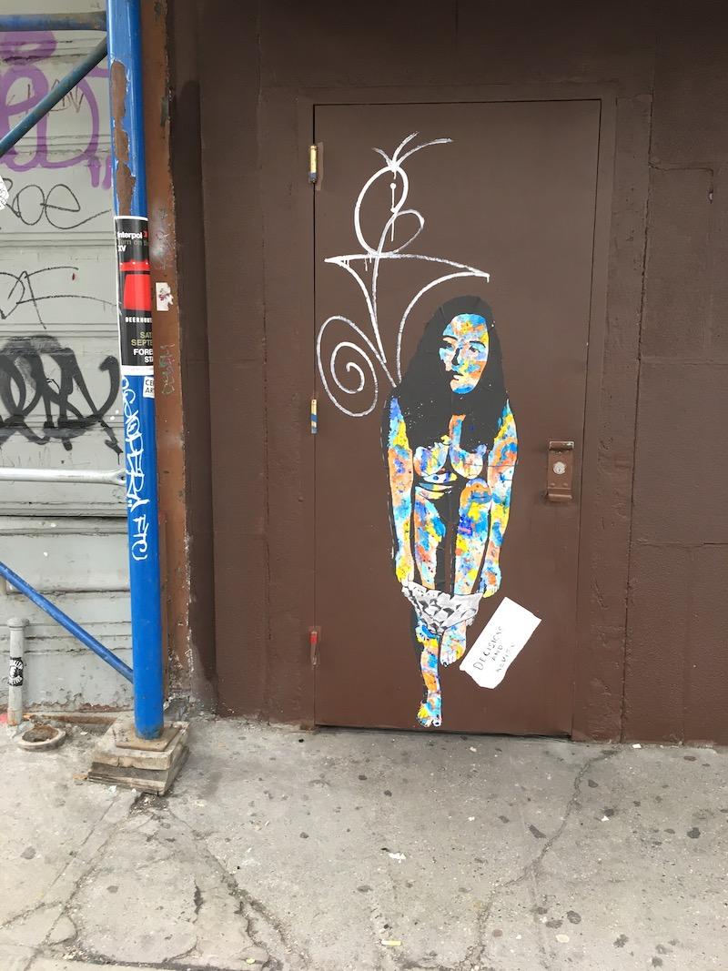 Street art on door in LES.