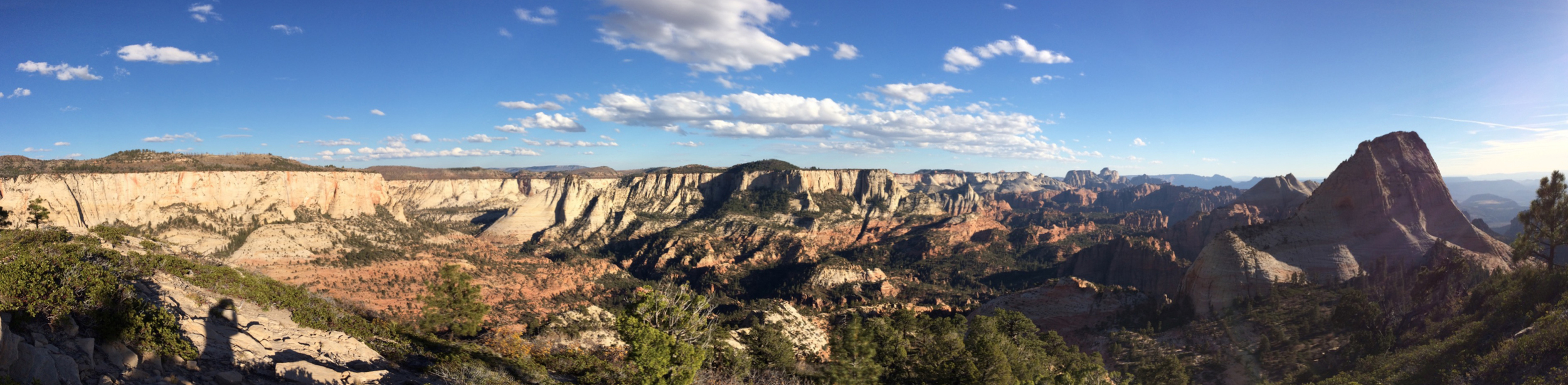 iPhone pano from atop East Northgate Peak.  Zion Canyon is in the distance and somewhere between me and the canyon is Subway.  The prominent peak on the right is the North Guardian Angel and the South Guardian Angel is just beyond that.