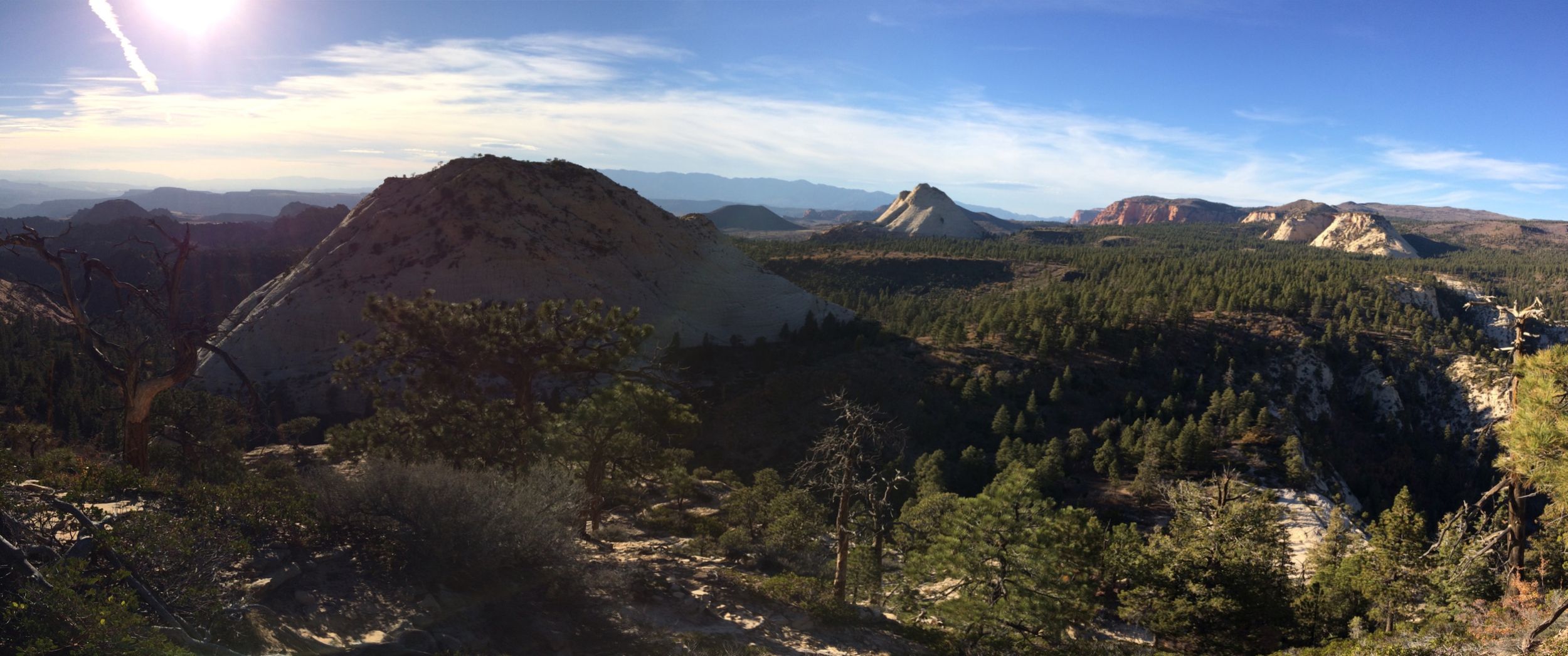 iPhone pano from atop East Northgate Peak.  The rounded summit in the left mid ground is West Northgate Peak.  The isolated white peak in the distance just right of center is Pine Valley Peak.