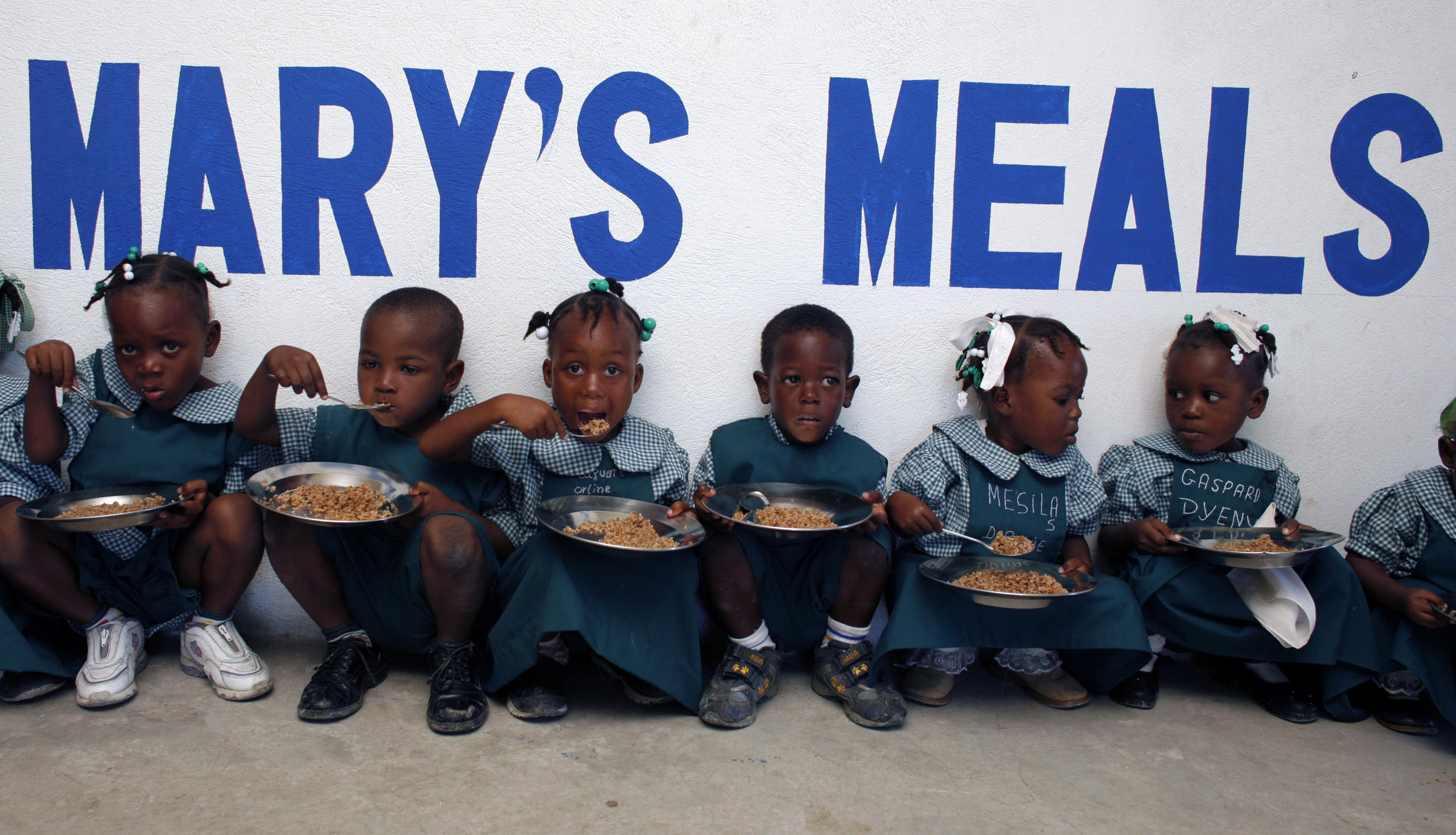 Mary's_Meals_comes_to_Cite_Soleil,_Haiti._PHOTO_BY_ANGELA_CATLIN.JPG