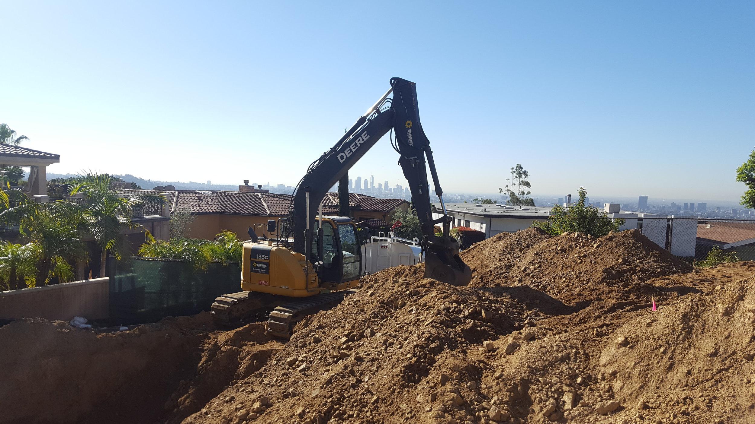 Hillside Excavation and grading project. 15 feet below grade, into Bedrock.