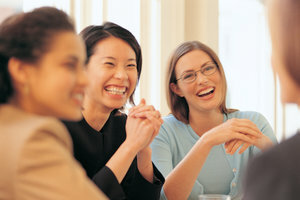 Businesswomen-laughing-in-meeting_dv496065b.jpg