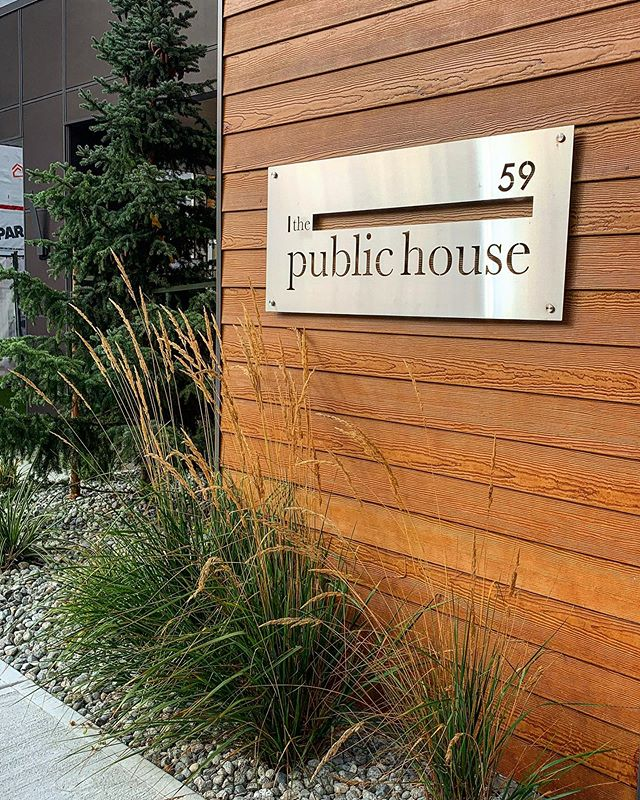 Contemporary West Coast design at The Public House at #58oncherryhill . Our sleek stainless steel sign design perfectly harmonizes with its surroundings. #ravbrardesign #westcoast #westcoastvibes #architecture #architecturephotography #westcoastdesign #modernliving #landscaping #landscapedetails #cedar