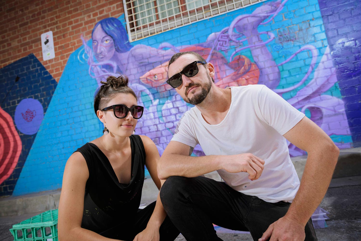Chuck Mayfield & Júlia Palazzo (Mayfield Palace) in front of their joint piece for Creative Pathways.