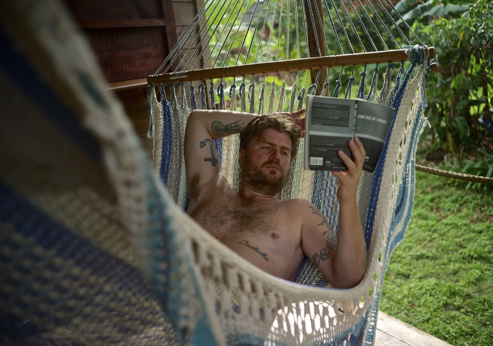 i don't read often but when i do i prefer to read in a hammock.  and i like to turn the page from behind my head.