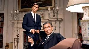 this scene from north by northwest has brilliant blocking and shot choices. this frames emphasis rodger thornhill's confusion and frustration by contrasting philip vandamm's comfort in what we believe to be his own space. is it a great photograph? not really.... but it serves its function and its part of a great sequence of shots.